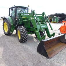 Used John Deere 6520 Cab tractor with front end loader