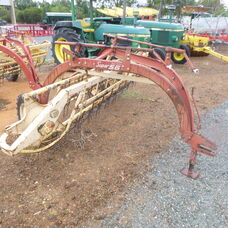 Used New Holland Super 56 roller bar rake